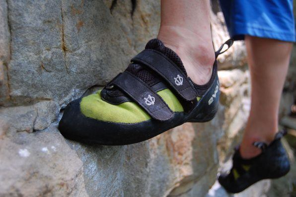 Climbing shoes on feet.