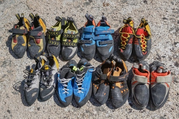 Many pairs of rock climbing shoes.
